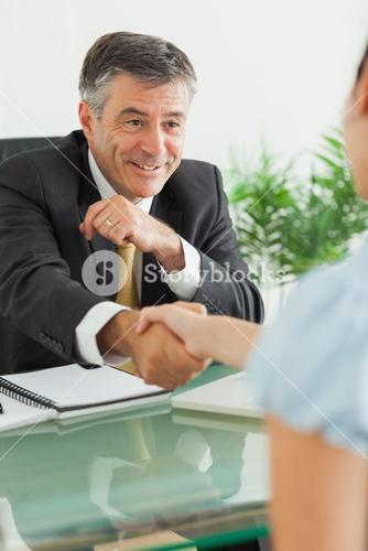Businessman shaking a womans hand
