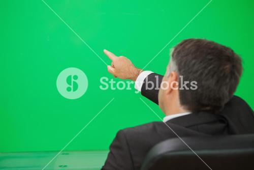 Man pointing to copy space