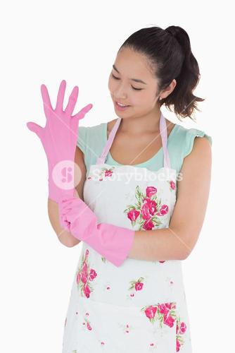 Woman pulling on rubber gloves