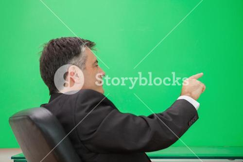 Welldressed man pointing to a copy space