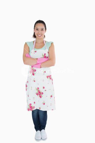 Woman wearing apron and rubber gloves