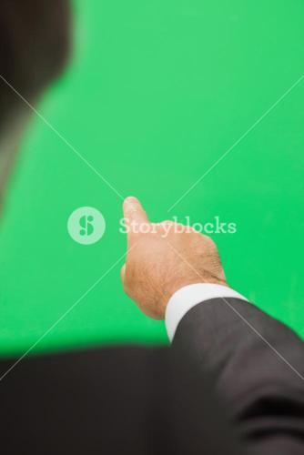 Man pointing to green copy space