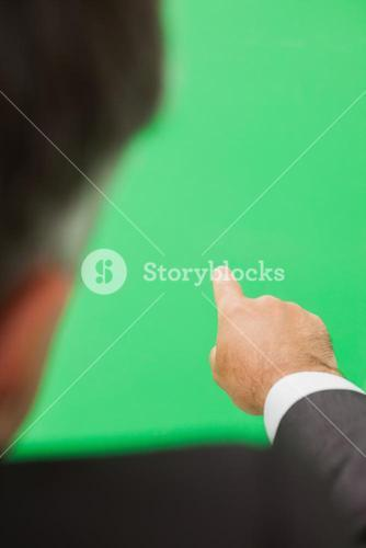Man pointing to green screen