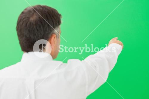 Welldressed businessman pointing to copy space