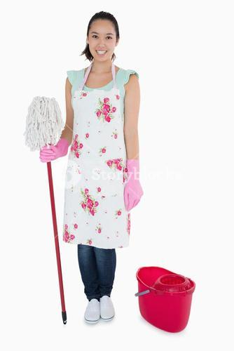 Happy woman with mop and bucket