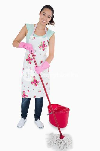 Smiling woman cleaning the floor