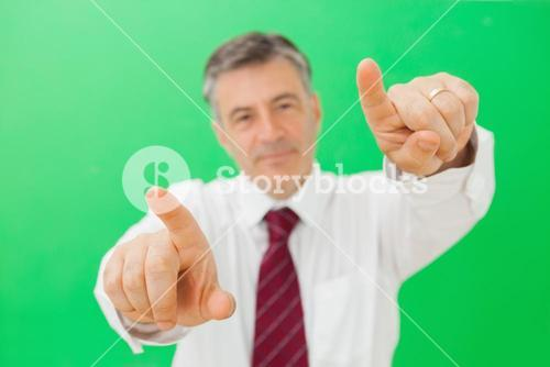 Man pointing with both hands
