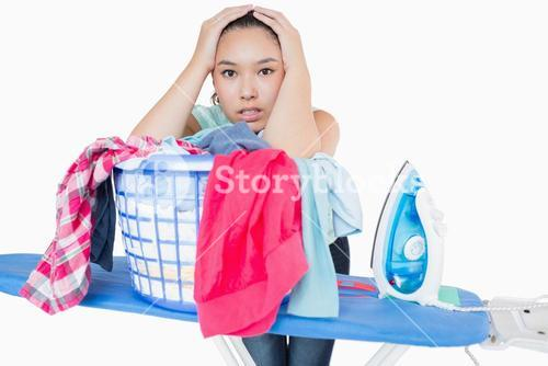 Woman fed up with ironing