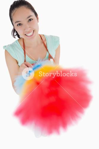 Happy woman holding a duster