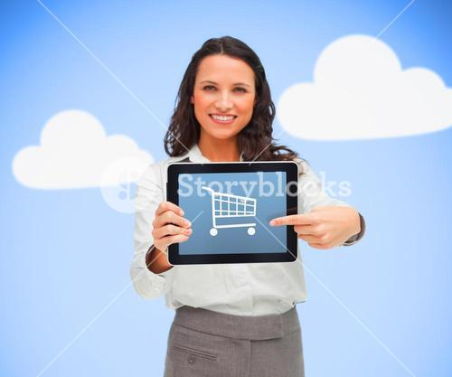 Businesswoman holding a tablet computer showing shopping app symbol against blue background