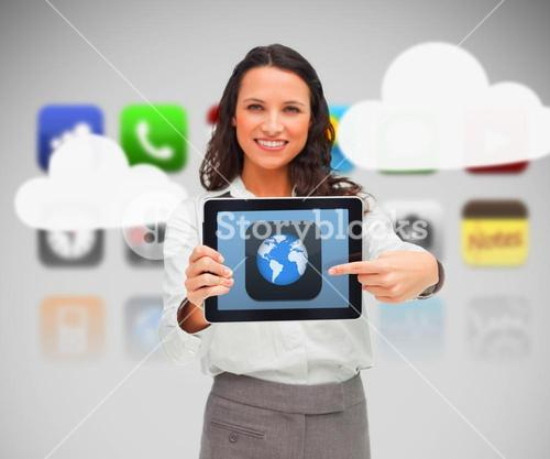 Woman holding a digital tablet showing world symbol