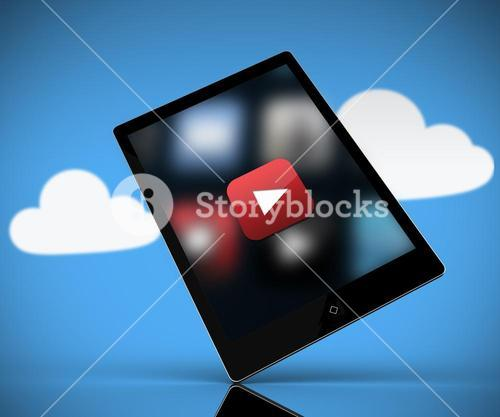 Tablet pc showing play button standing against background with clouds