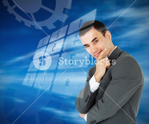 Businessman standing against blue background