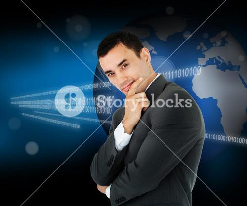 Businessman standing in front of a world map