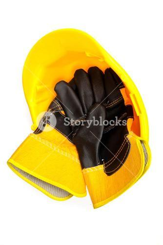 builders gloves in a hard hat