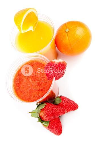 Orange and strawberry juice standing
