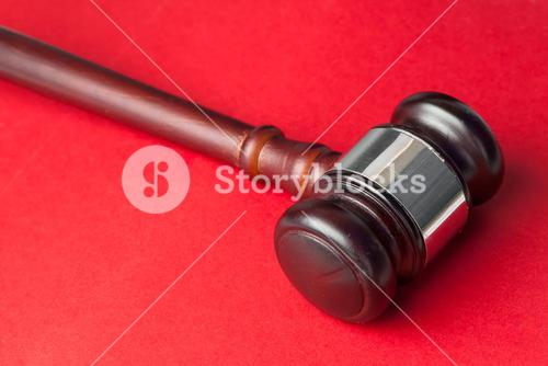 Gavel on a red background