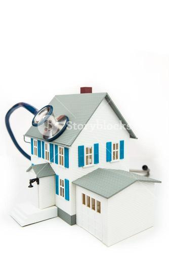 Blue stethoscope taking care of the house