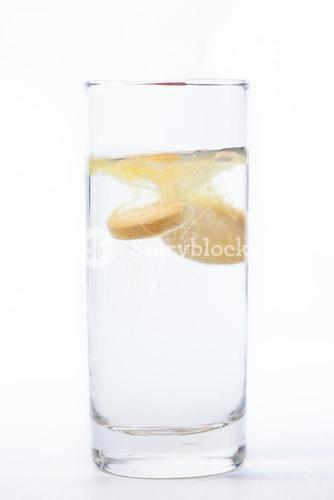 Vitamin tablet dissolving in water