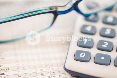 Close up of glasses and calculator