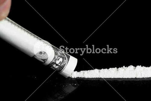 Person taking a line of illegal white substance