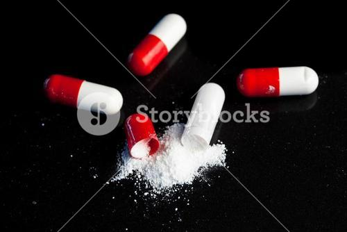 Red and white pills broken