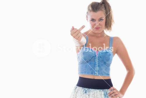 Cheeky woman showing middle finger