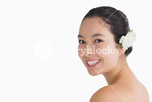 Black haired woman wearing a flower in her hair