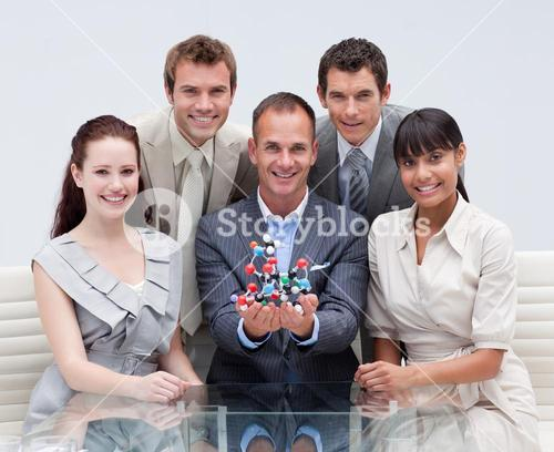 Business team holding molecules. Scientific business
