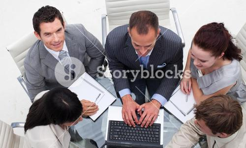 High angle of businessman working with his team