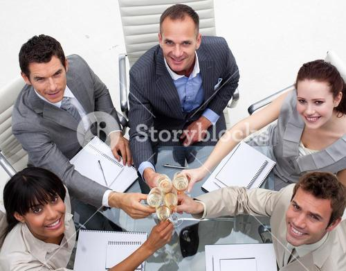 High angle of business team celebrating a success with champagne