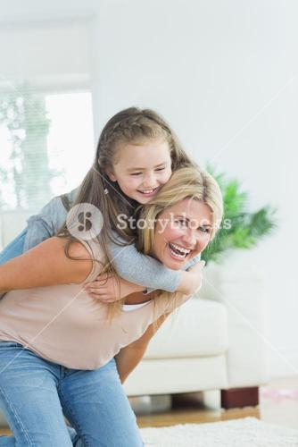 Mother giving daughter a piggy back