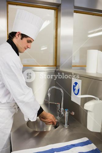 Concentrated chef washing hands