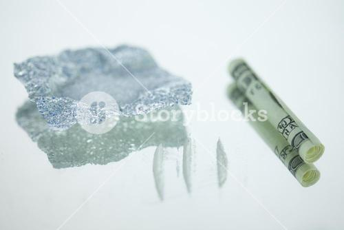 Lines of drugs with rolled up bank note and foil wrap