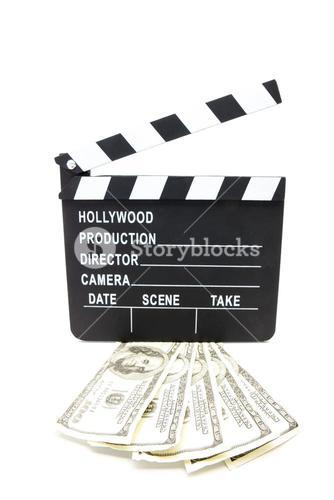 Fanned out dollars under film slate