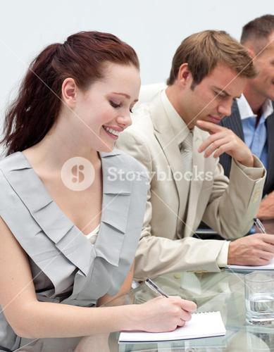 Attractive businesswoman making notes
