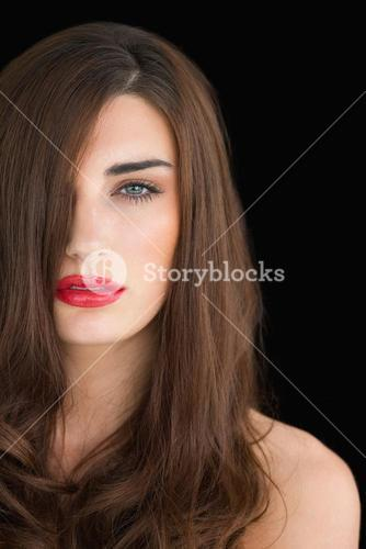 Woman with red lips looking at camera