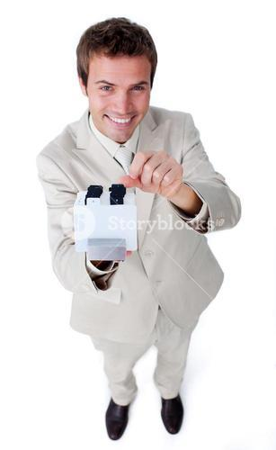 Young businessman holding a book at the camera