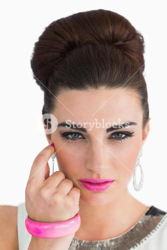 Woman posing with beehive and pink lips