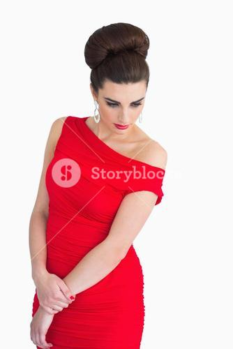 Woman with red dress looking glamorous
