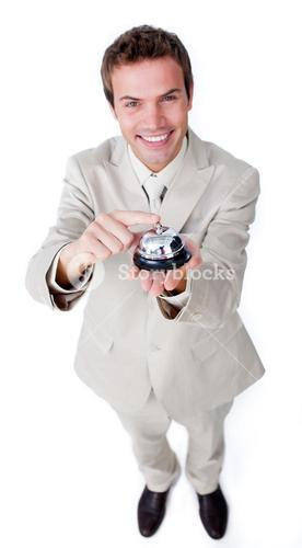 Positive businessman using a bell