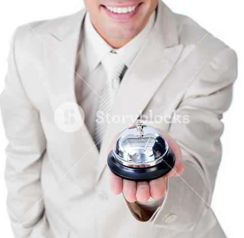 Happy businessman using a bell
