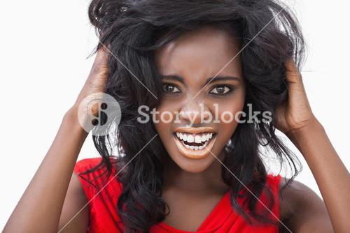 Woman tousling her curly hair