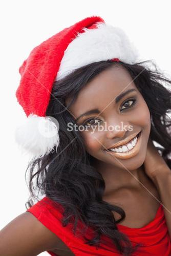 Woman wearing red dress and Santa Claus hat