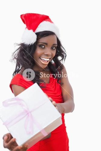 Festive woman standing holding a gift