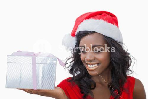 Woman standing looking at a gift