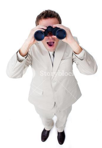 Confident businessman using binoculars