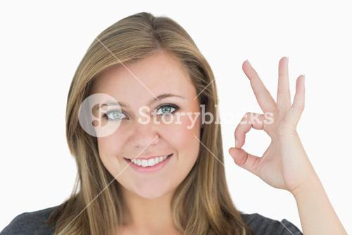 Woman making hand sign