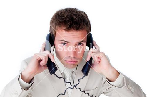 Handsome businessman having a phone call