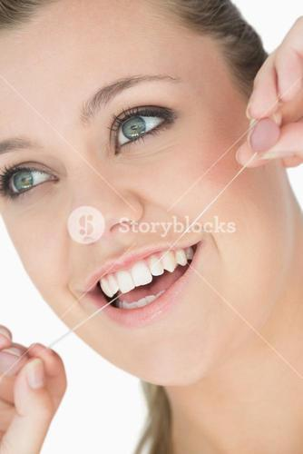 Woman with dental floss